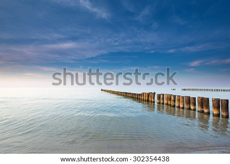 Twilight on the calm Baltic sea - stock photo