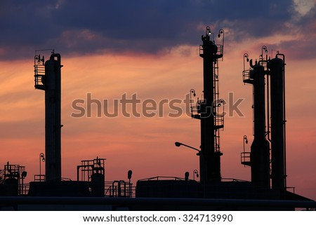 twilight over petrochemical factory silhouette - stock photo