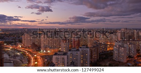 Twilight panoramic cityscape. Aerial view. Typical modern residential area. - stock photo