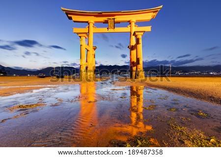 twilight reflection scene of Torii at Itsukushima Shrine HDR  - stock photo