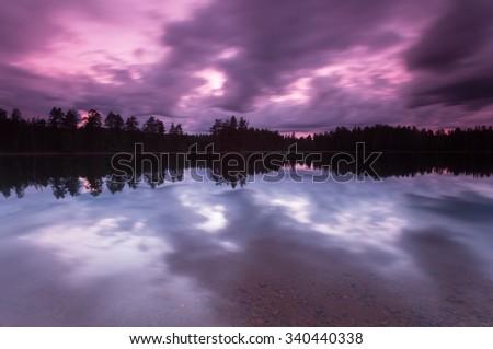 Twilight scene over a calm lake, dalarna, sweden - stock photo