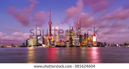 Twilight shot with the Shanghai skyline and the Huangpu river, China - stock photo