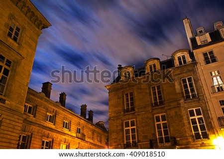 Twilight sky at evening time against architectural structures in Paris - stock photo