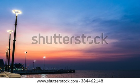 twilight sky with colorful sunset and clouds at beach