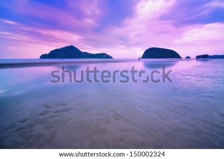 Twilight time at beautiful beach and cloudscape - stock photo