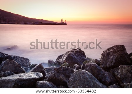 Twilight time on a rocky shore - stock photo