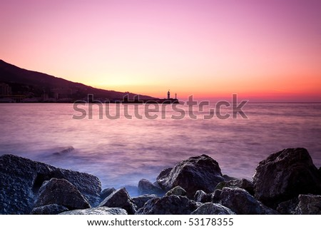 Twilight time on a rocky shore. Crimea, Ukraine - stock photo