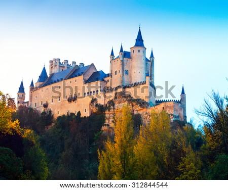 twilight view of Alcazar of Segovia in  autumn time. Castile and Leon, Spain
