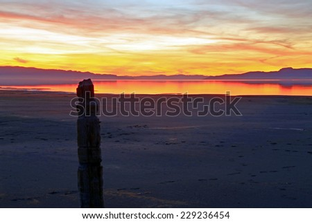 Twilight with an old wooden post at the Great Salt Lake, Utah, USA. - stock photo