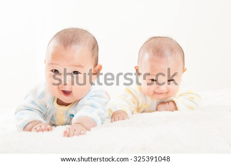 Twin baby, Japanese - stock photo