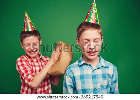 Twin boys making fun on April foolâ??s day - stock photo