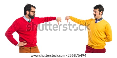Twin brothers doing bad signal  - stock photo