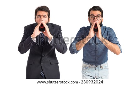 Twin brothers shouting over isolated white background