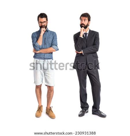 Twin brothers thinking over isolated white background - stock photo