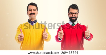 Twin brothers with thumb up  - stock photo