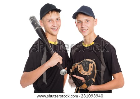 Twin brothers - young baseball players isolated on white background - stock photo