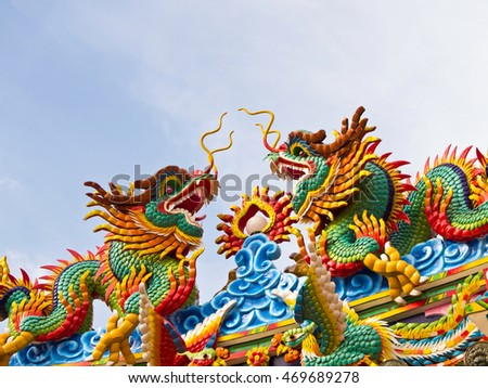 Twin Chinese Dragon sculpture on the roof