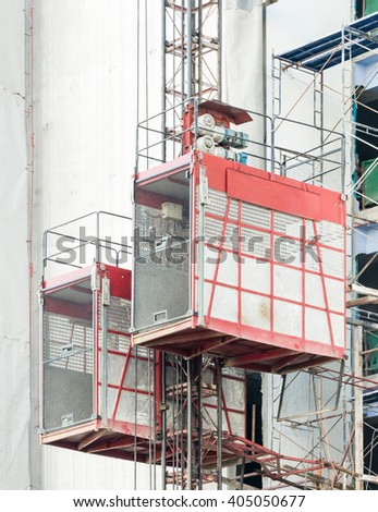 Twin construction elevator for worker in the urban of Thailand.