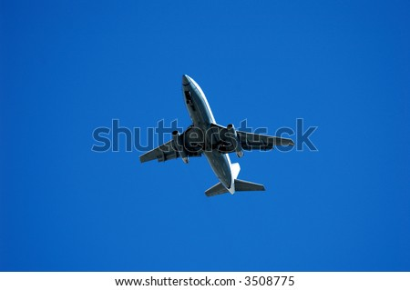 Twin engine jet plane overhead on flight path to land, landing approach 737, 3