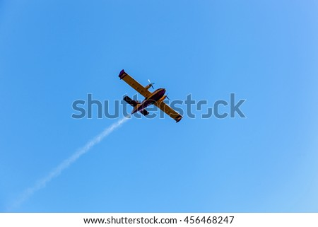 Twin-engine plane flying lonely in the blue sky,Aerial performance