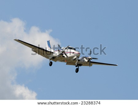 Twin engine propeller airplane approaching for landing