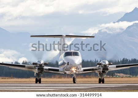 Twin engine turbo prop private or commuter airplane - stock photo