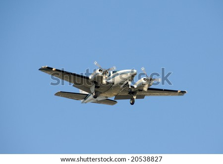 Twin engine turboprop airplane approaching