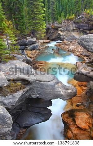 Twin Falls Creek flows through a narrow gorge in Yoho National Park of Canada - stock photo