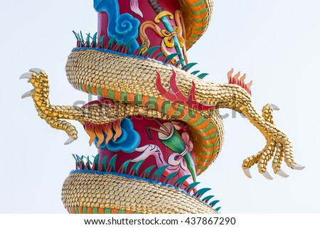 Twin golden claw of the dragon sculpture in the Chinese temple. - stock photo