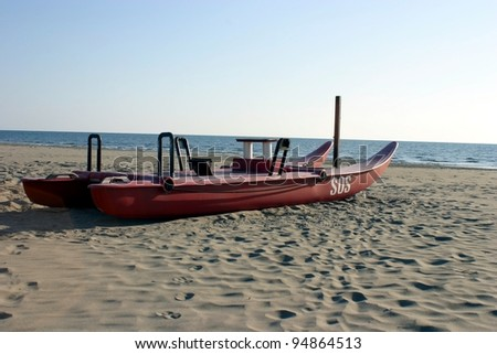 Twin-hulled rowboat, lifeboat in winter time in Tuscany, Italy