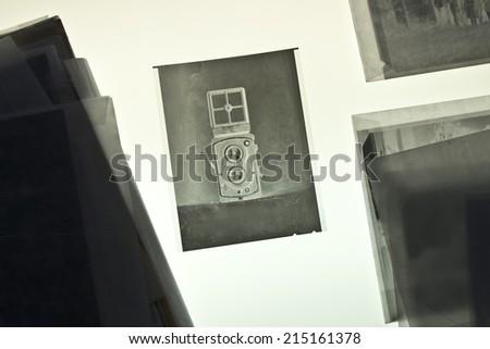 Twin-lens reflex camera on negative material - stock photo