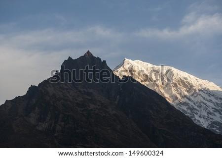 Twin peaks in Lang tang, Nepal. - stock photo