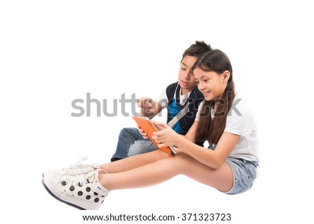 Twin sibling sister brother use tablet for education