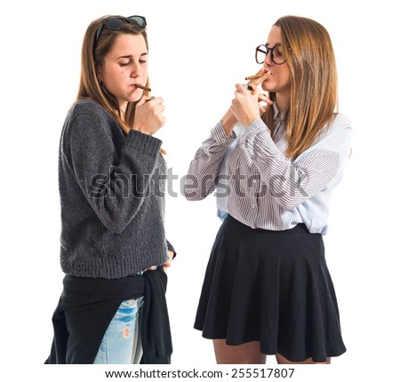 Twin sisters smoking