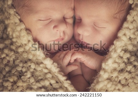 Twins and newborn and shape of heart - stock photo