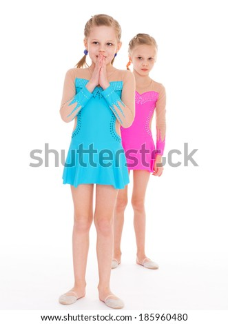 twins, kids, girls, gymnast, sport- adorable twin girls gymnasts. Isolated on white background.