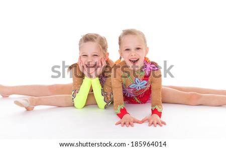 twins, kids, girls, gymnast, sport- adorable twin girls gymnasts. Isolated on white background. - stock photo
