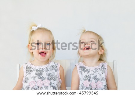 Twins Laughing Having Fun Playing - stock photo