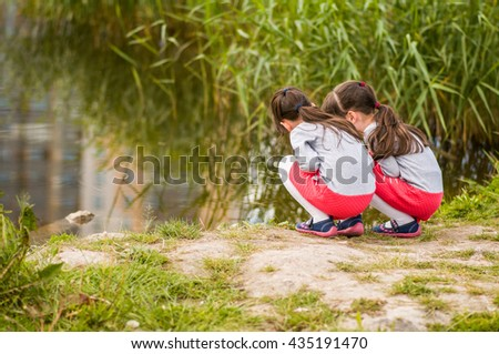 Twins look at the water - stock photo