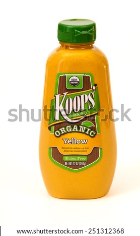 TWINSBURG, OH, USA - FEBRUARY 7, 2015: A bottle of Koop's Organic Yellow Mustard on white. - stock photo