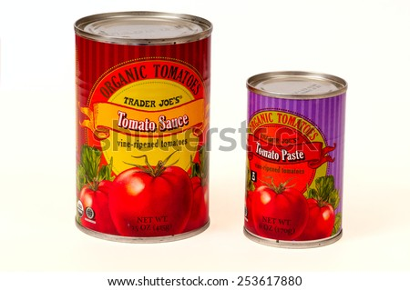 TWINSBURG, OH, USA - FEBRUARY 7, 2015: Two cans of Trader Joe's Organic Tomato Sauce and Tomato Paste. Trader Joe's is headquartered in Monrovia, California, and has stores in over 39 states. - stock photo