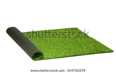 twisted artificial green grass isolated on white