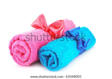 Twisted blue and pink towels with bands isolated on white