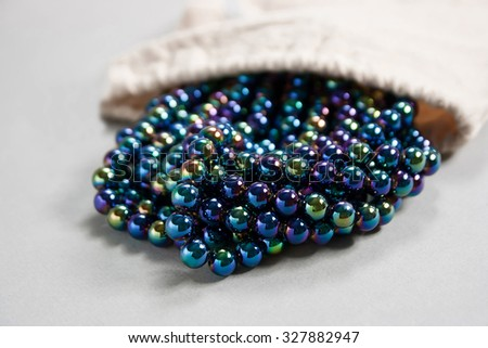 twisted dark  pearls on the table