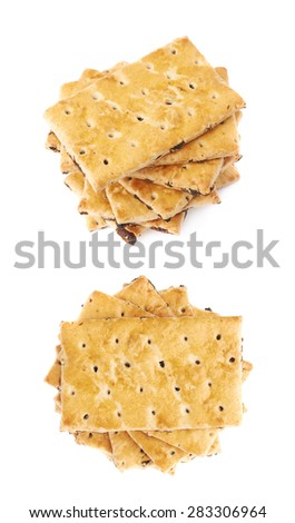 Twisted stack of raisins cracker cookies isolated over the white background, set of two different foreshortenings - stock photo