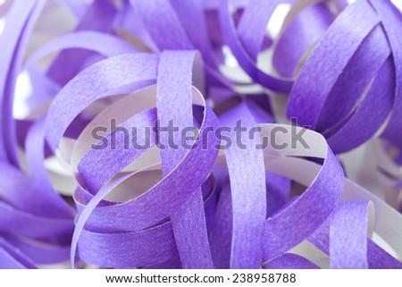 twisted violet paper ribbons. Macro lens closeup shot 1:1 - stock photo