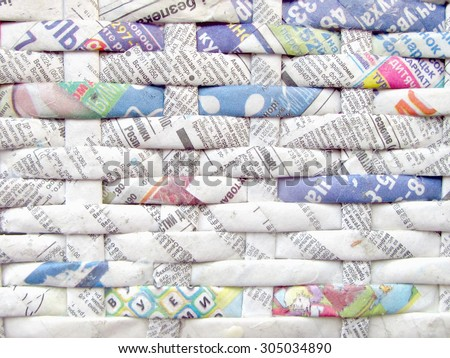 Twisted weaving newspapers. Abstract textured background. Cyrillic letters. - stock photo