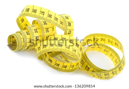 Twisted yellow measuring tape - stock photo