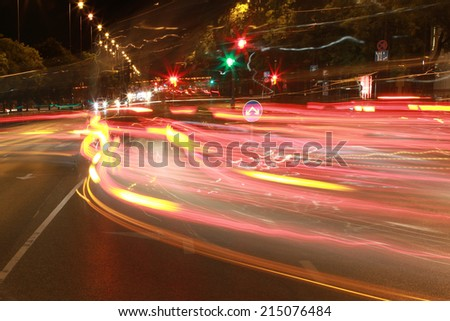 twisting car light trails - stock photo