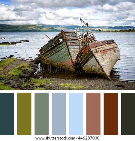Two abandoned fishing boats in Salen Sound, Isle of Mull, Inner Hebrides, Scotland. In a colour palette with complimentary colour swatches. - stock photo